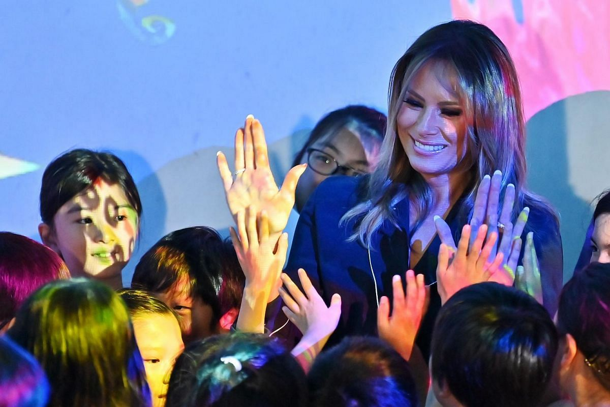 US first lady Melania Trump meets children while visiting the Mori Building Digital Art Museum in Tokyo on May 26, 2019.