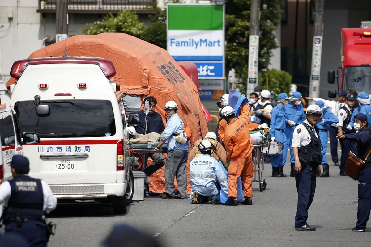 A handout photo shows rescue workers and police officers operating at the site where sixteen people were injured in a suspected stabbing by a man, in Kawasaki, Japan May 28, 2019. PHOTO: KYODO VIA REUTERS