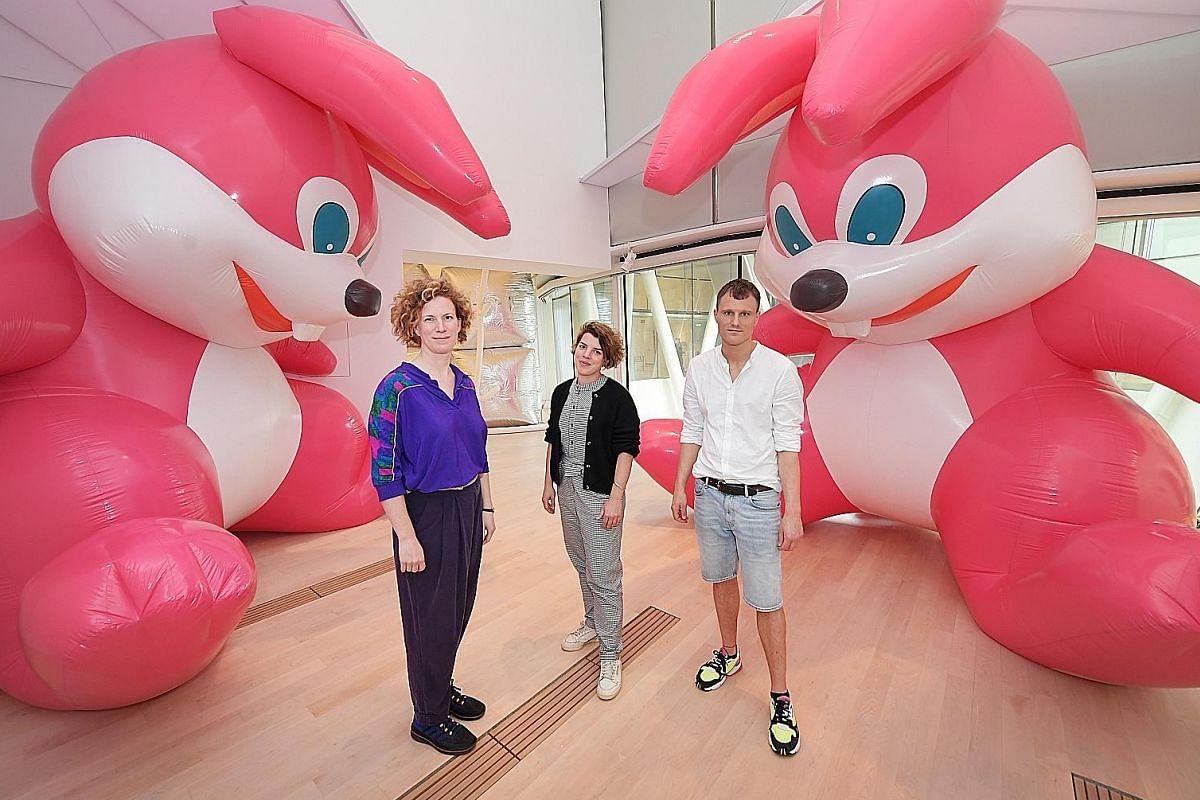 Floating Utopias curators (from left) Anna Hoetjes, Fabiola Bierhoff and Artur van Balen with Momoyo Torimitsu's Somehow, I Don't Feel Comfortable.