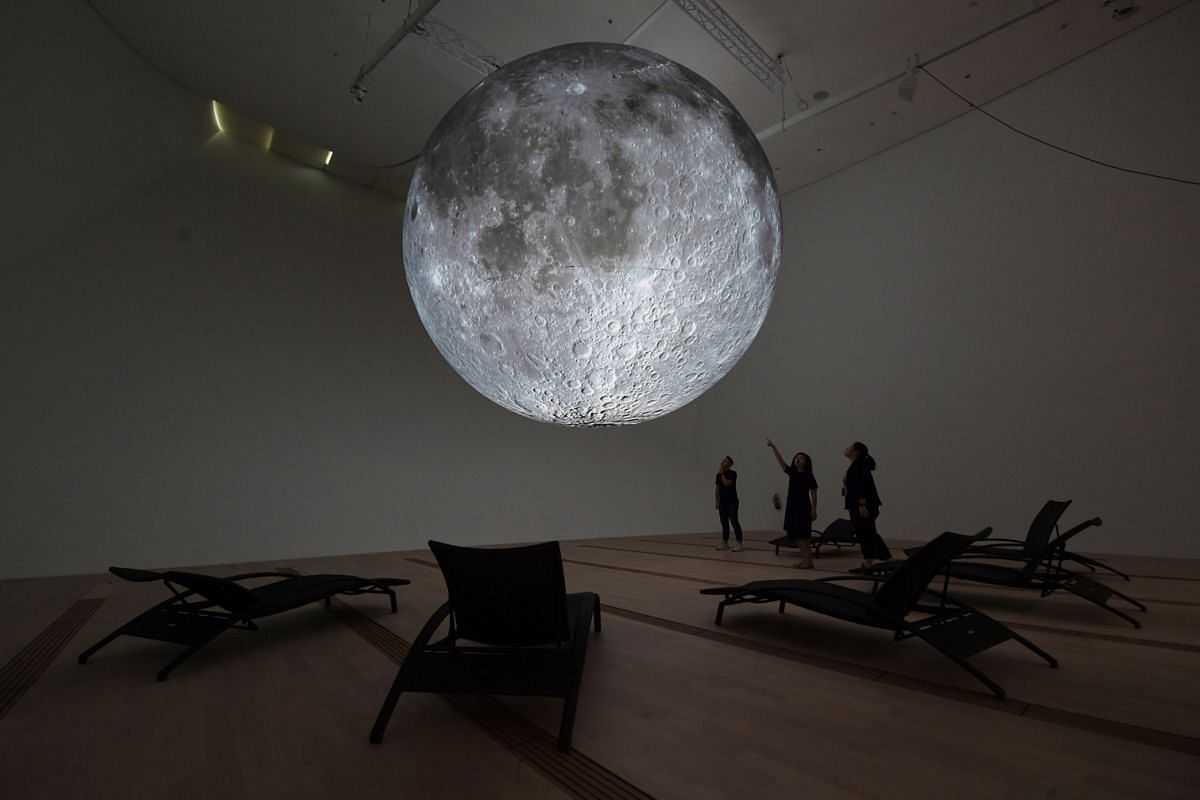 """""""Moon-bathe"""" beneath this inflatable sculpture by British artist Luke Jerram, installed to mark the 50th anniversary of the Apollo 11 moon landing."""