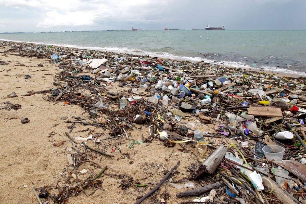 A stretch of beach at East Coast Park strewn with plastic bottles and other debris, May 28, 2019. According to the National Environment Agency website, offshore detritus drifts onto the shores of Singapore during the south-west monsoon months from Ma