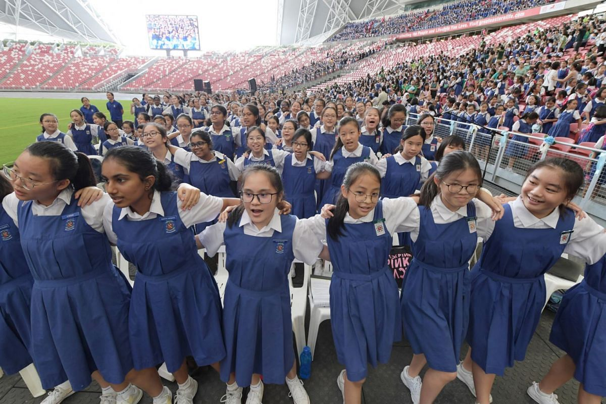 CHIJ schools celebrating their 165th anniversary at the National Stadium, May 28, 2019. The event drew 18,000 students, past and present, and included a thanksgiving mass led by Archbishop William Goh. PHOTO: THE STRAITS TIMES/ ALPHONSUS CHERN