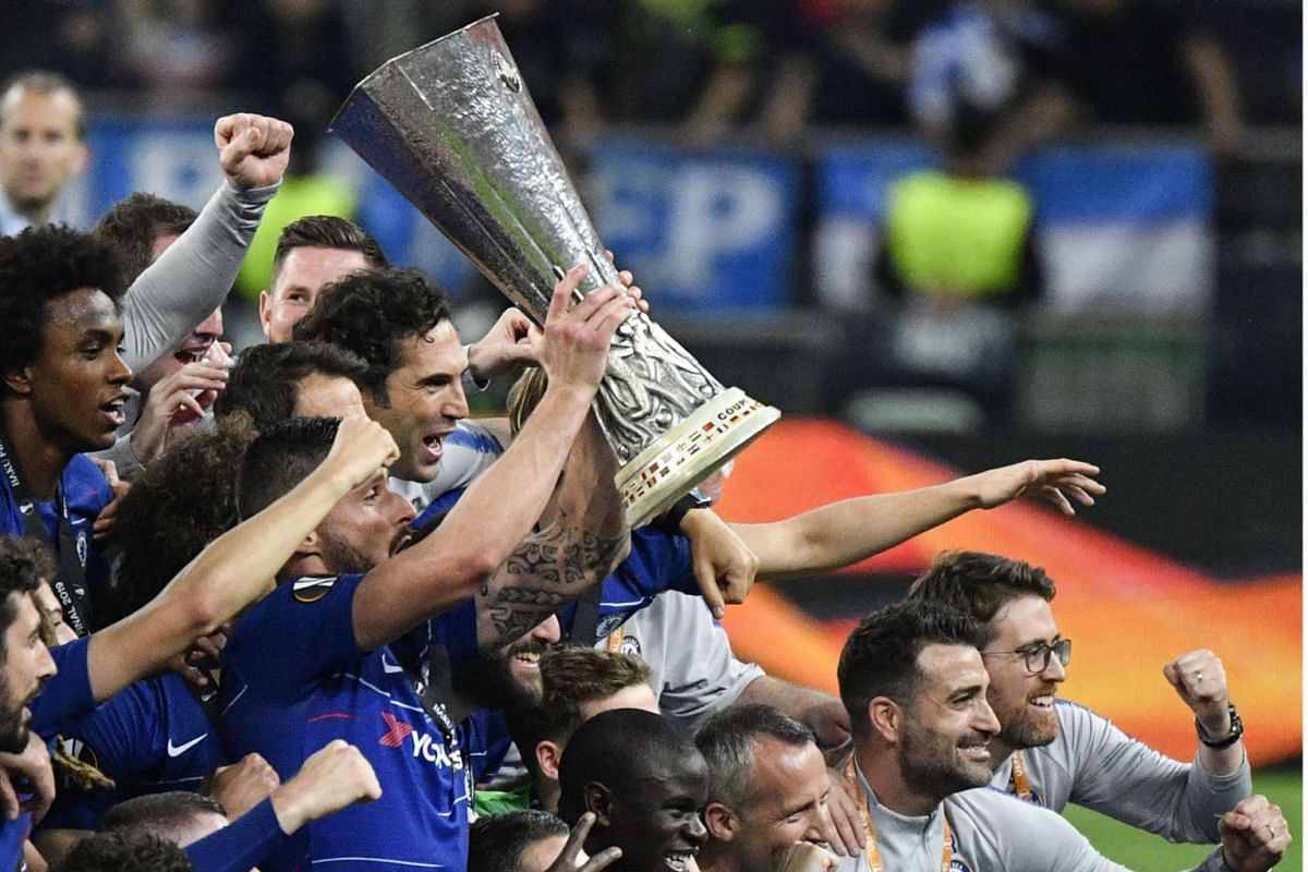 Chelsea players celebrate with the trophy after the UEFA Europa League final football match between Chelsea FC and Arsenal FC at the Baku Olympic Stadium in Baku, Azerbaijian on May 29, 2019. PHOTO: AFP