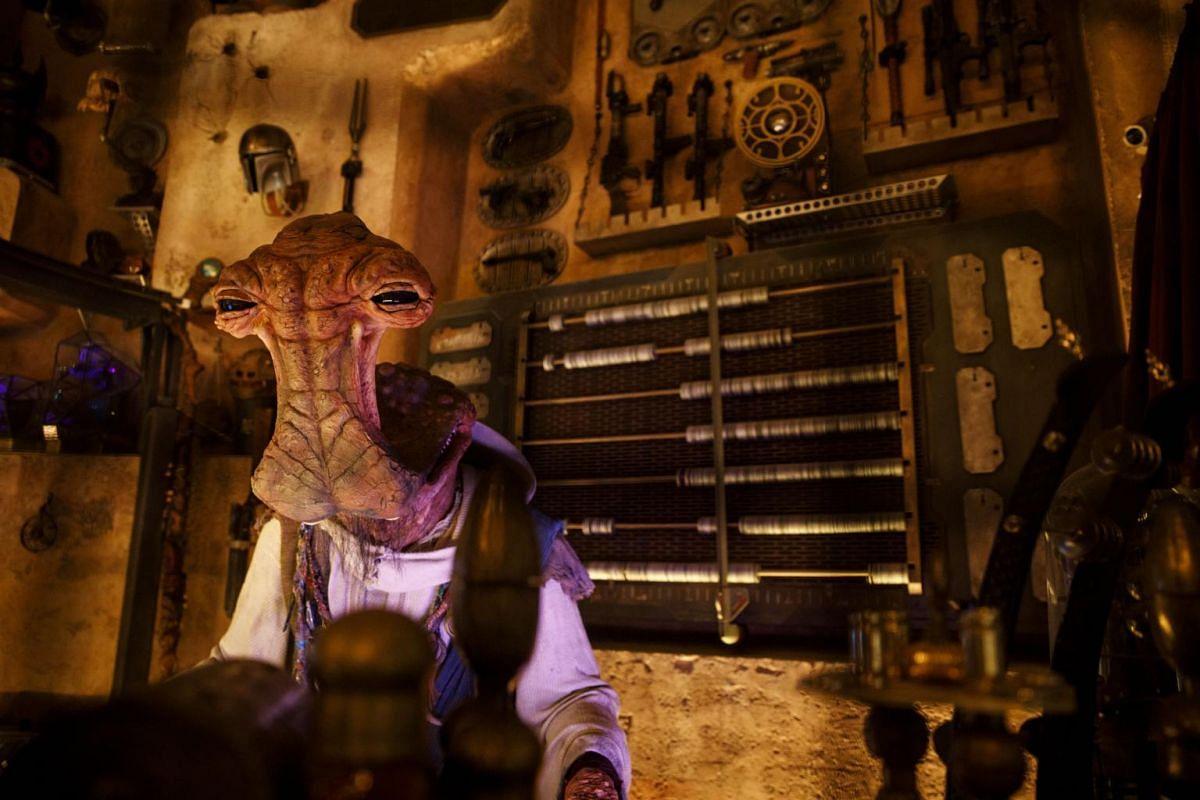 An audio-animatronic Dok-Ondar figure stands inside Dok-Ondar's Den of Antiquities at the Star Wars: Galaxy's Edge at the Disneyland theme park in Anaheim, California.