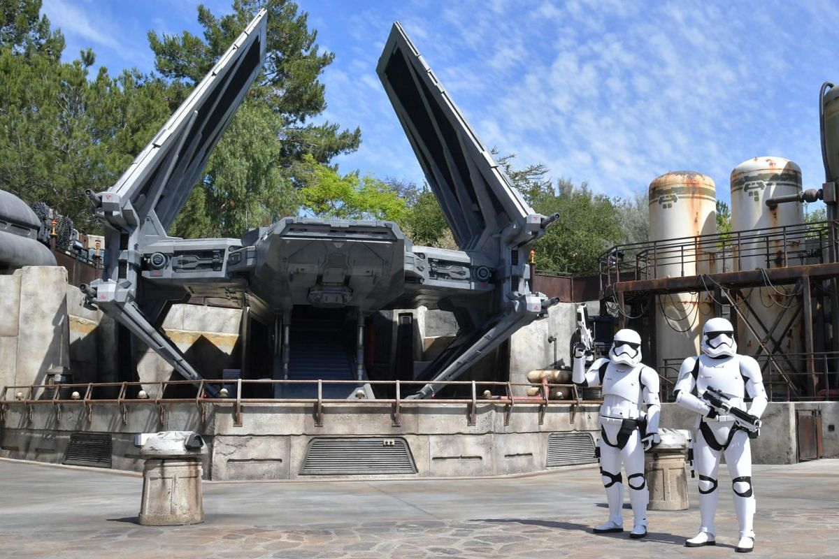 Stormtroopers and a TIE Echelon transport ship on display at a media preview of Star Wars: Galaxy's Edge in Disneyland on May 29, 2019, in Anaheim, California.