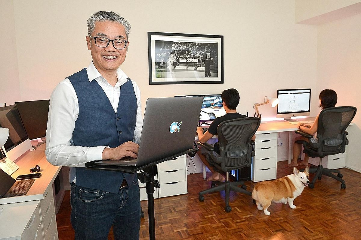 Mr Air Vongxayasy, director of operations of the customer-experience department at American tech company Cisco, shares his home office space with his son and his wife.