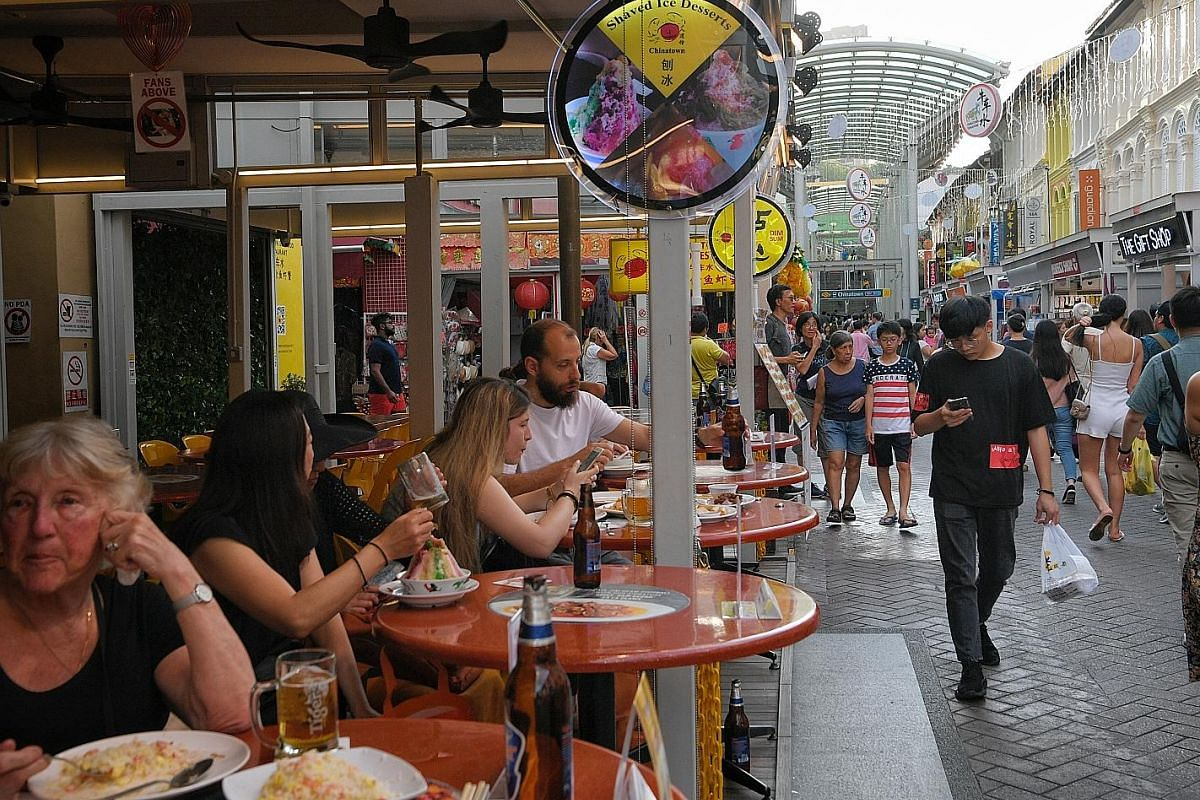 Tourists who visit Chinatown taking a respite from the hot weather with cold drinks, as well as to sample the fare, such as seafood.