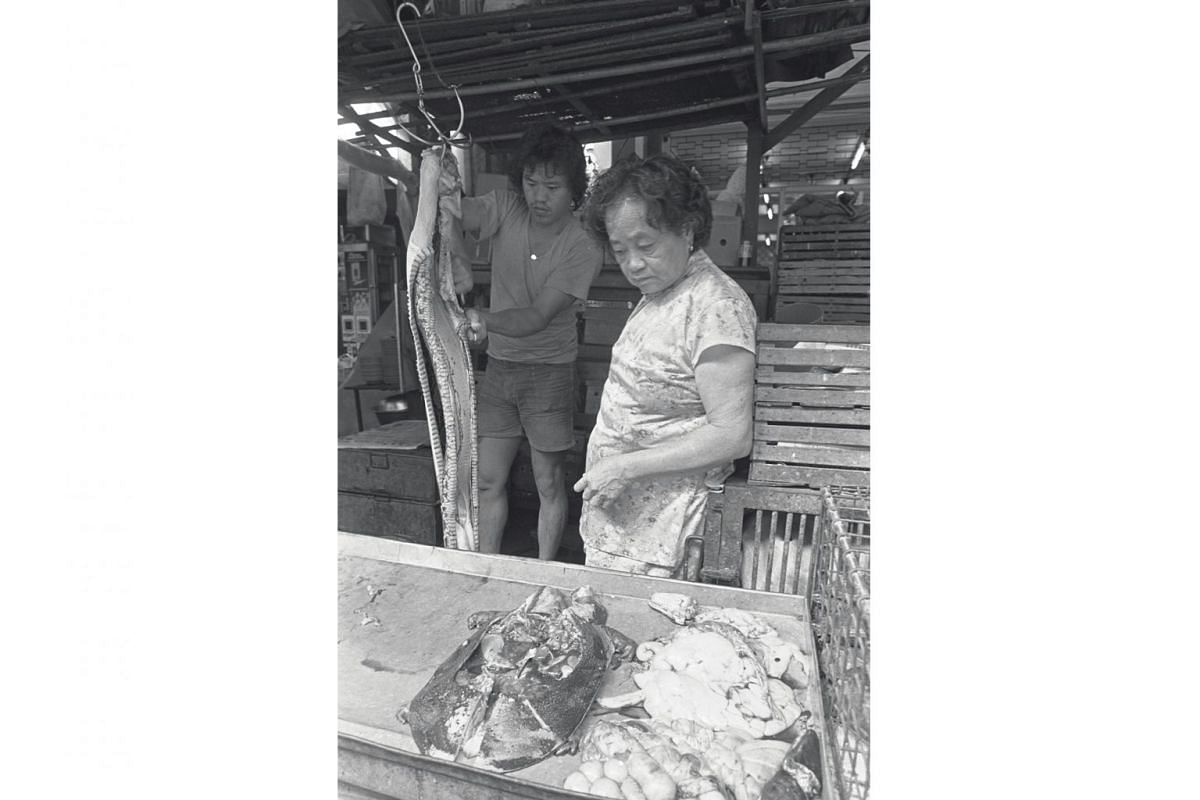 This stallholder (right), known as Ah Soh, ran a live meat stall in Smith Street and became well-known worldwide as the Singapore Tourism Board, as well as many tourists, took photographs and videos of her skilfully killing snakes, skinning them and chopp