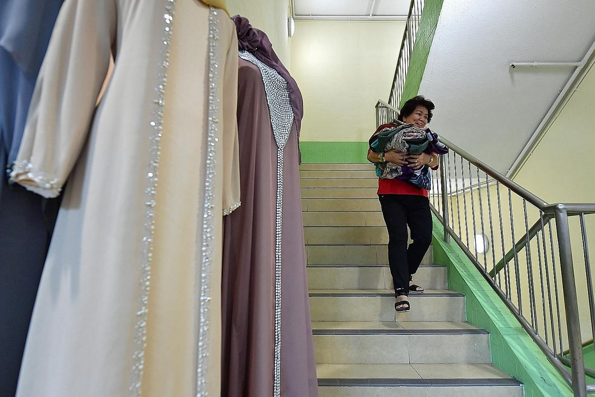 An average day sees Madam Lie running up and down the stairs between her two shop units on the third floor of Joo Chiat Complex (above), and her office and workstation on the fourth floor.