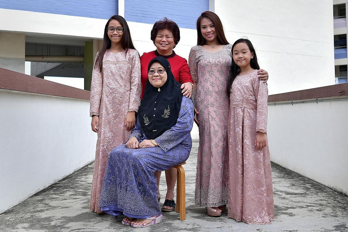 One of Madam Lie's loyal customers is Madam Zaiton Kuning (seated), 63, whose daughter Siti Norbaya, 43, also frequents the shop with her daughters Nur Syarah Aliah (far left), 13, and Nur Batrisya Qailah, 11. They are wearing this year's Hari Raya outfit