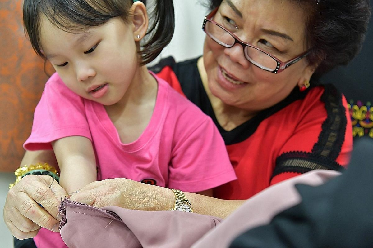 Madam Lie and her granddaughter Heidi Huang, five, who often visits the shop to watch her mother and granny at work.