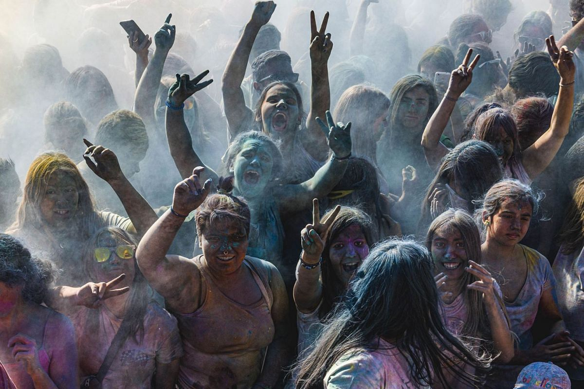 Participants of the 'Holi Barcelona' festival are covered by colored powder as they dance to the soundtracks of Bollywood and Bhangra during a celebration of the traditional Hindu spring festival, June 2, 2019, Spain.