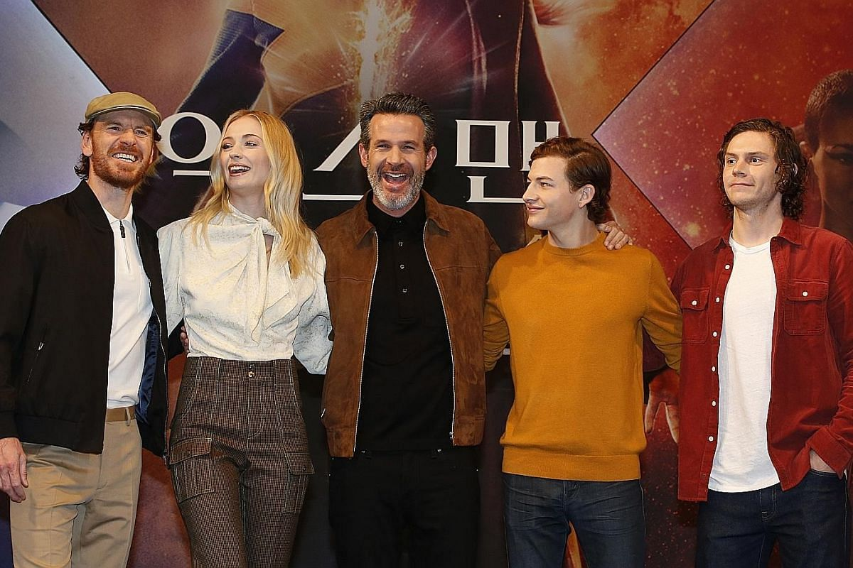 Sophie Turner plays powerful psychic Jean Grey and her alter ego, the titular character, in Dark Phoenix. Dark Phoenix director Simon Kinberg (centre) with stars (from far left) Michael Fassbender, Sophie Turner, Tye Sheridan and Evan Peters at a pre