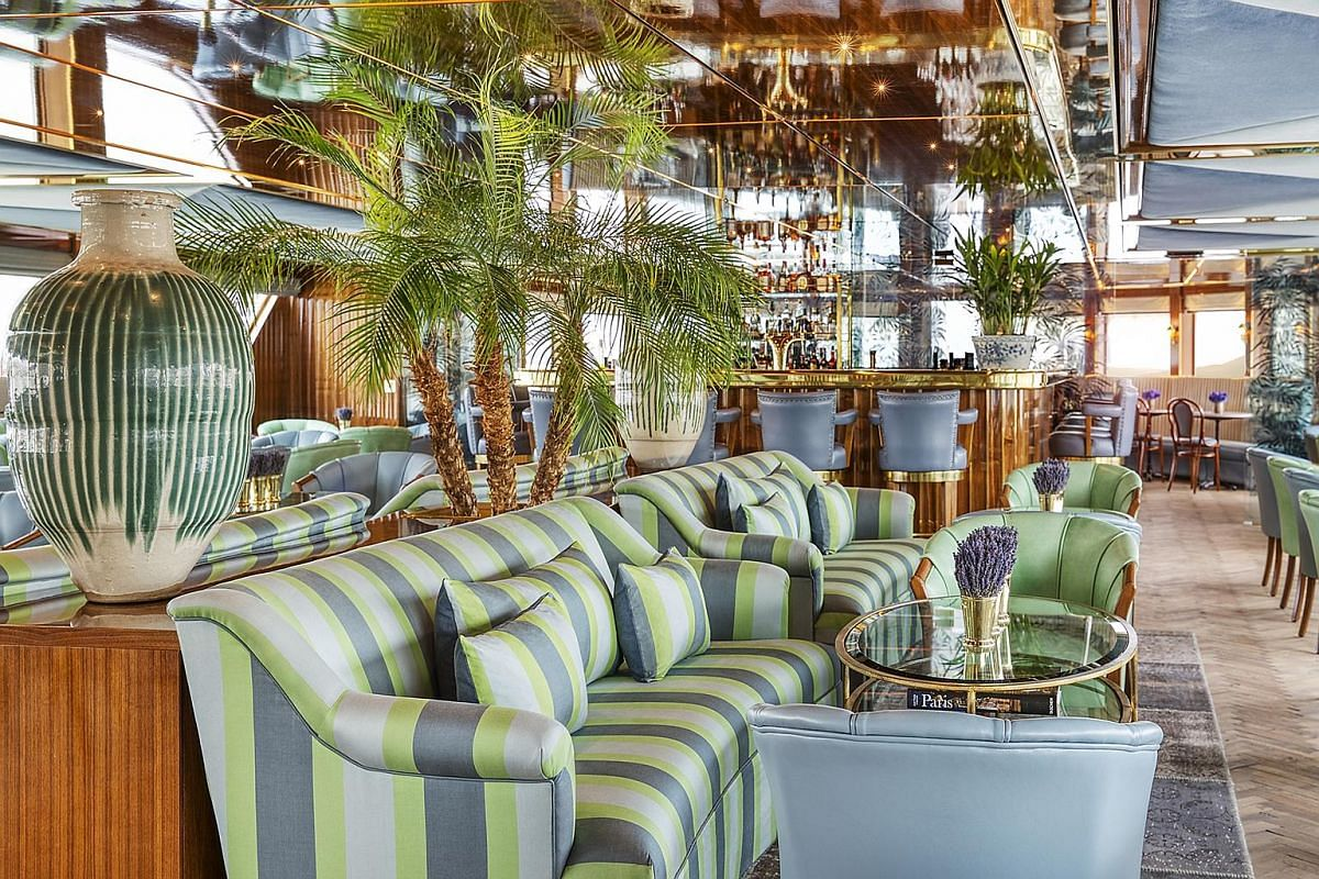 The sea-green decor of Le Salon Champagne bar and lounge on board Uniworld's S.S. Bon Voyage is inspired by the late designer Yves Saint Laurent's home in Marrakesh.