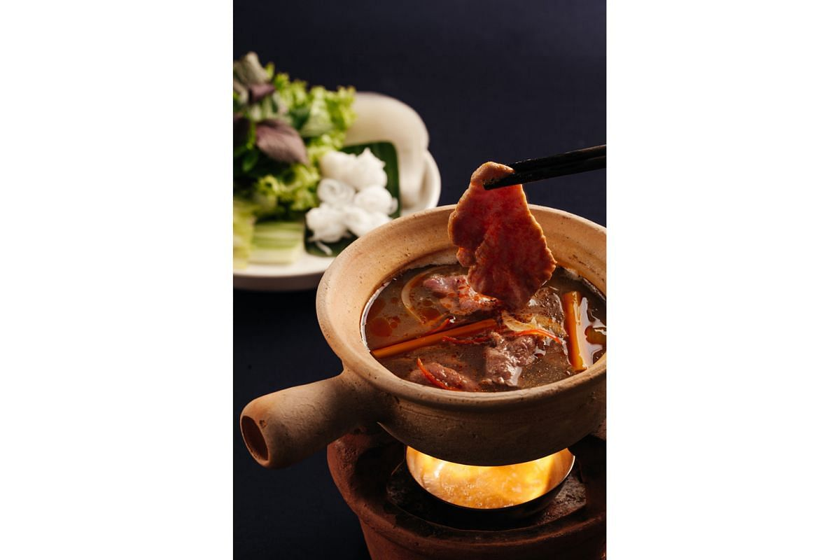 Hoa Tuc offers an extensive menu of Vietnamese dishes presented in original ways, including a dish called tender beef dipped in hot pot (above) that came with a claypot of piquant stock over a roaring charcoal fire.