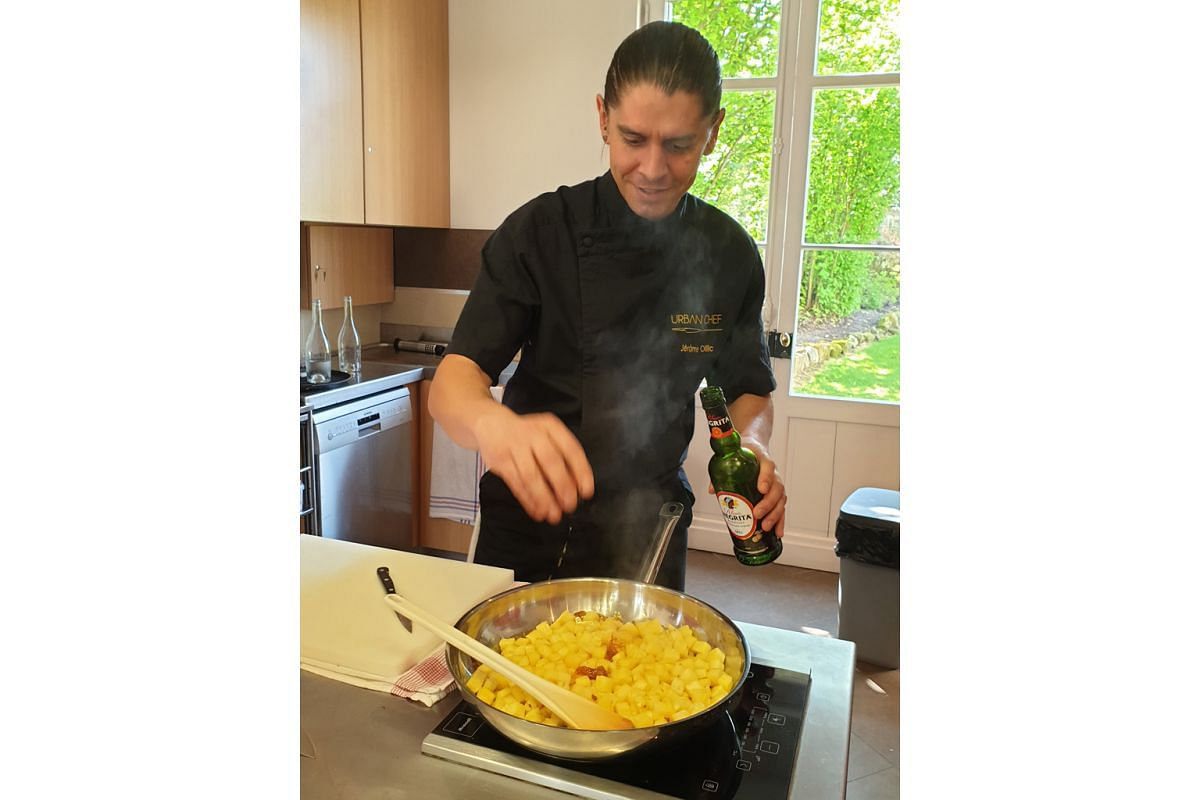 Chef Jerome Oillic (above) conducting a class on how to make a caramelised pineapple dessert with rum and vanilla
