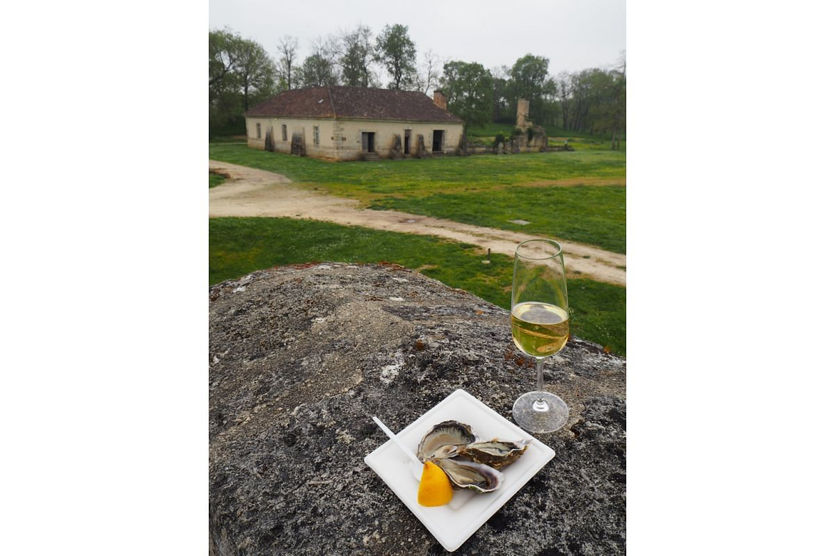 Oysters with champagne (above) at Fort Medoc, Bordeaux.