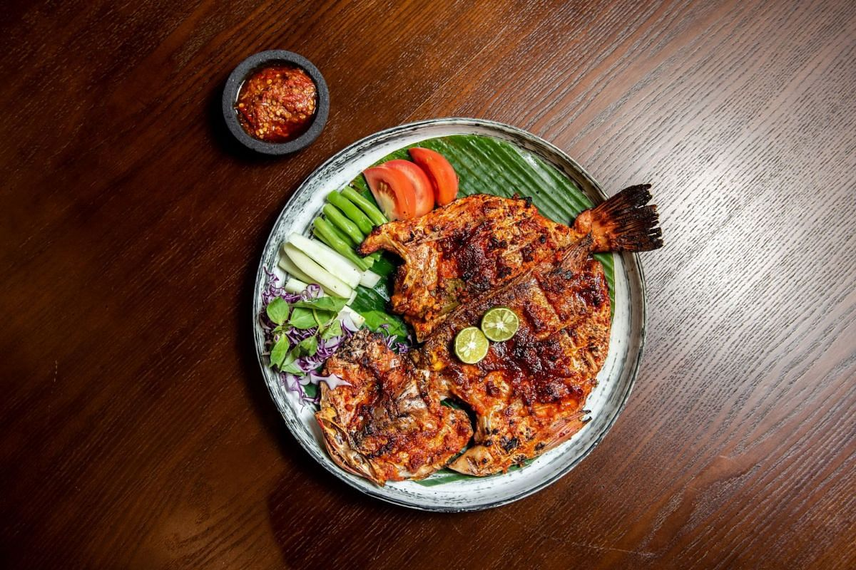 The Kakap Merah Bakar Jimbaran is a red snapper smeared with Balinese shrimp paste and Javanese sweet soya sauce, and grilled spread-out in a style popular on Bali's Jimbaran beach.