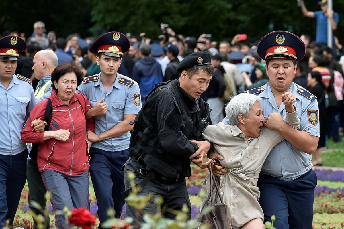 Police officers detain opposition supporters during a protest against the presidential election in Almaty, Kazakhstan, June 9, 2019.