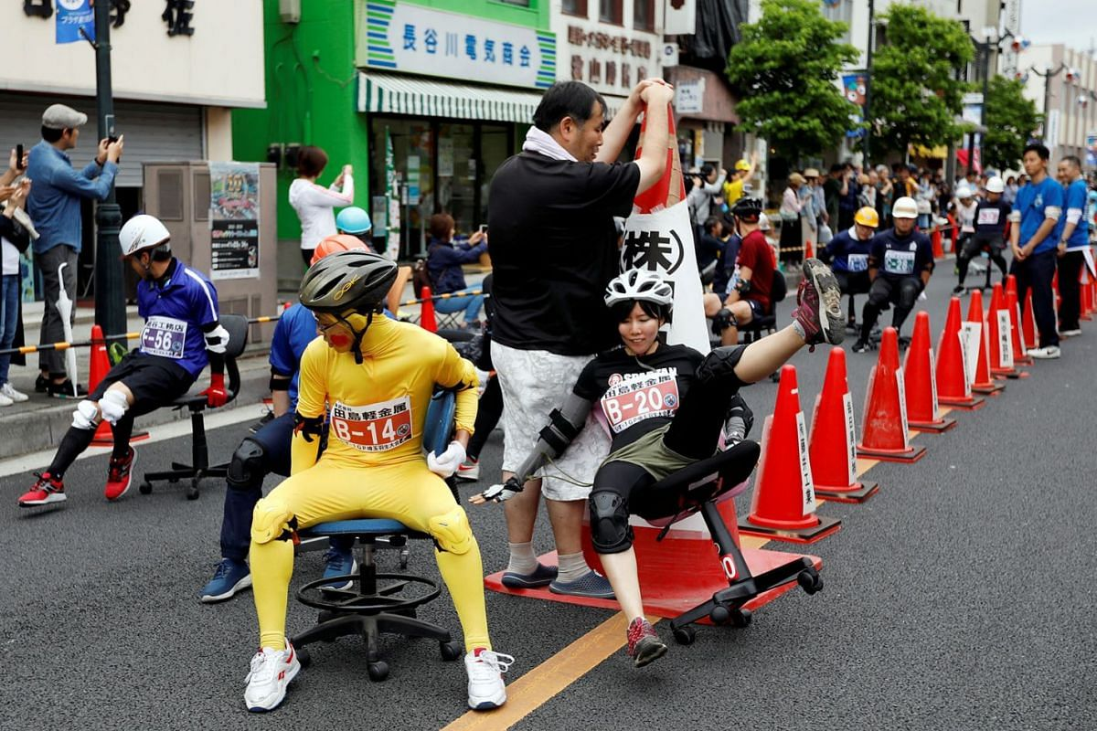 A racer crashes while taking part in the office chair race ISU-1 Grand Prix series, in Hanyu, north of Tokyo, Japan, June 9, 2019.