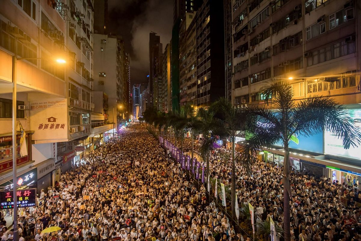 Demonstrators march during a protest against a proposed extradition law in Hong Kong, China, on Sunday, June 9, 2019. Hong Kong's Beijing-backed government faced new pressure to withdraw legislation easing extraditions to China after as many as 1 mil