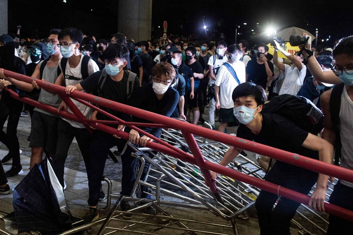 Protesters block the protest area at the Legislative Council with barricades during clashes with police after a rally in Hong Kong, on June 10, 2019.