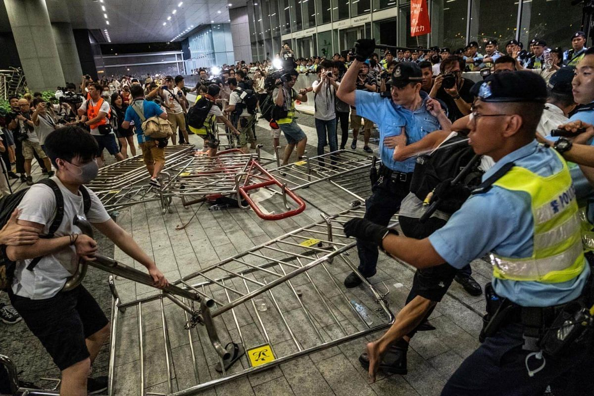 Demonstrators and police officers clash during a protest in Hong Kong, on June 10, 2019.