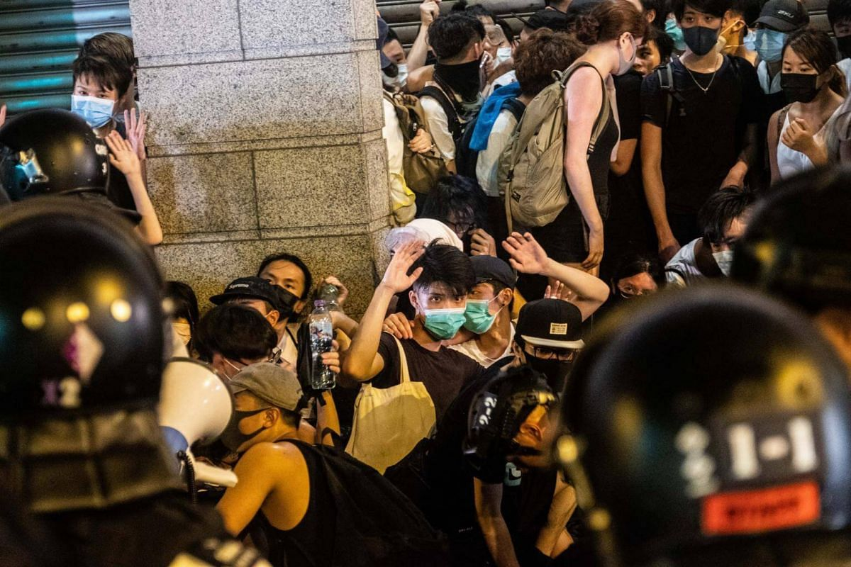 Demonstrators are detained by riot police officers after a protest in Hong Kong, on June 10, 2019.