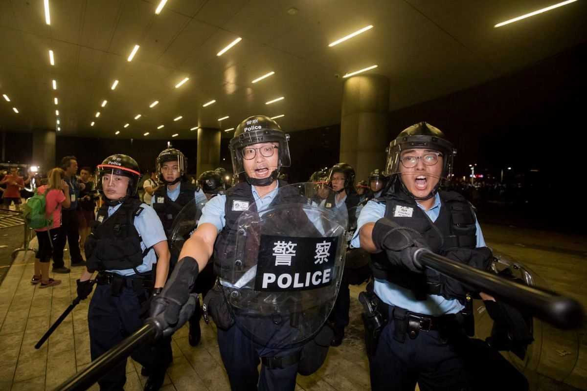 Police officers in riot gear direct demonstrators outside the Legislative Council during a protest in Hong Kong, on June 10, 2019.
