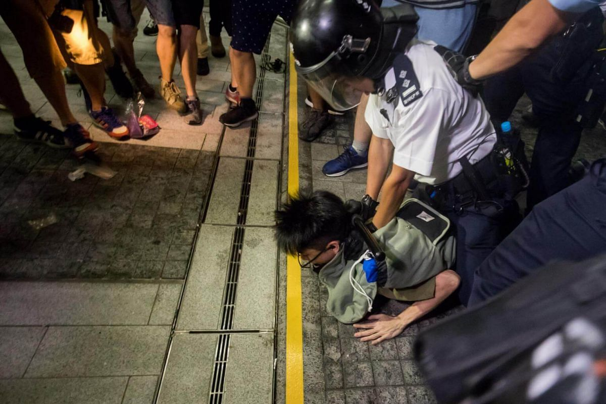 Police detain a demonstrator outside the Legislative Council during a protest in Hong Kong, on June 10, 2019.
