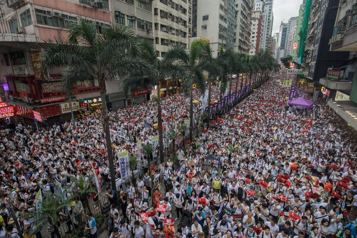 Demonstrators march during a protest in Hong Kong, on June 9, 2019.
