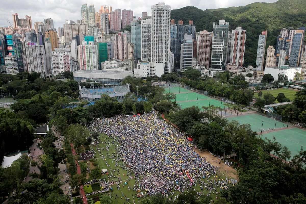 Demonstrators hold yellow umbrellas, the symbol of the Occupy Central movement, during a protest against a proposed extradition law in Hong Kong, on June 9, 2019.