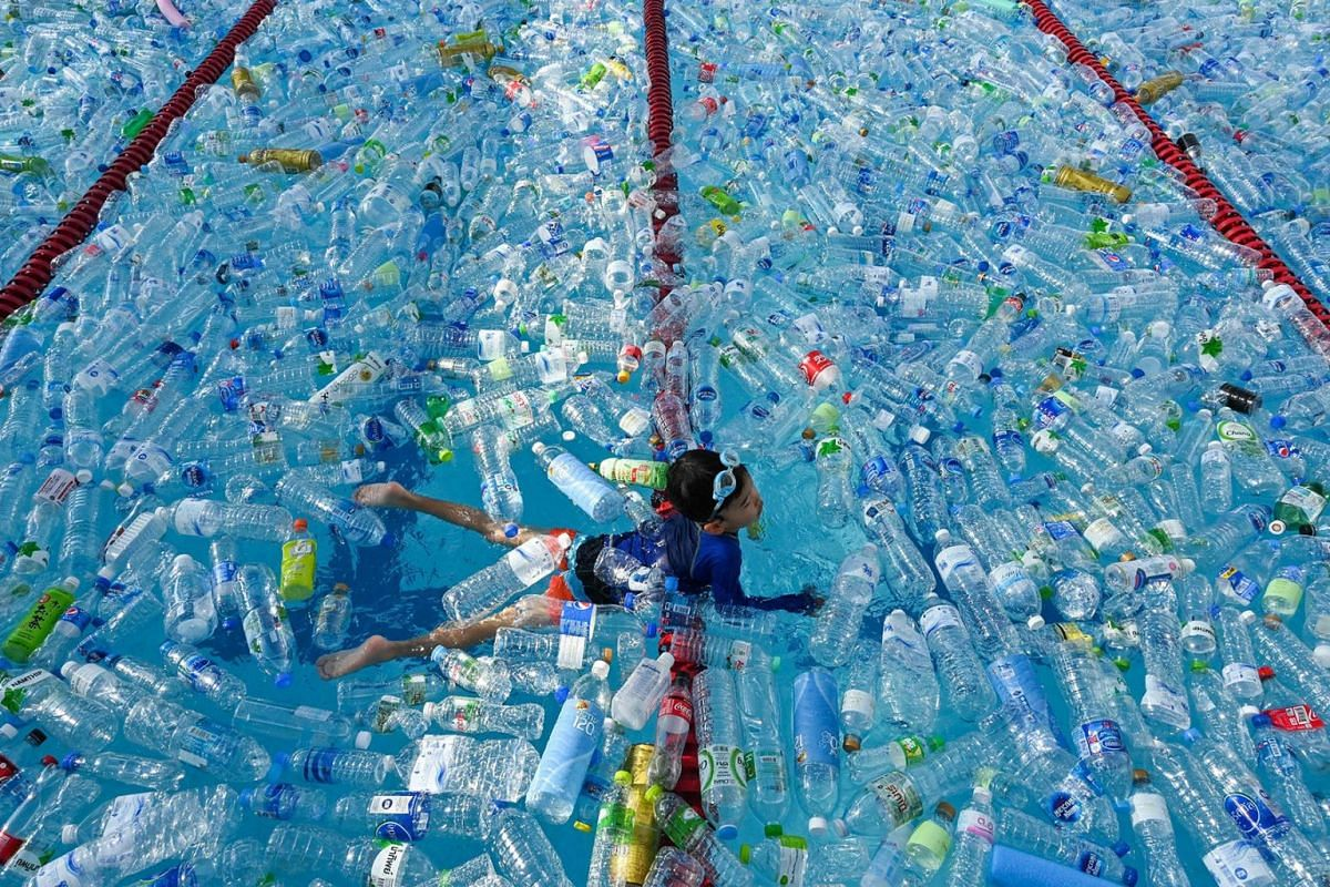 A child swims in a pool filled with plastic bottles during an awareness campaign to mark the World Oceans Day in Bangkok, Thailand, on June 8, 2019.