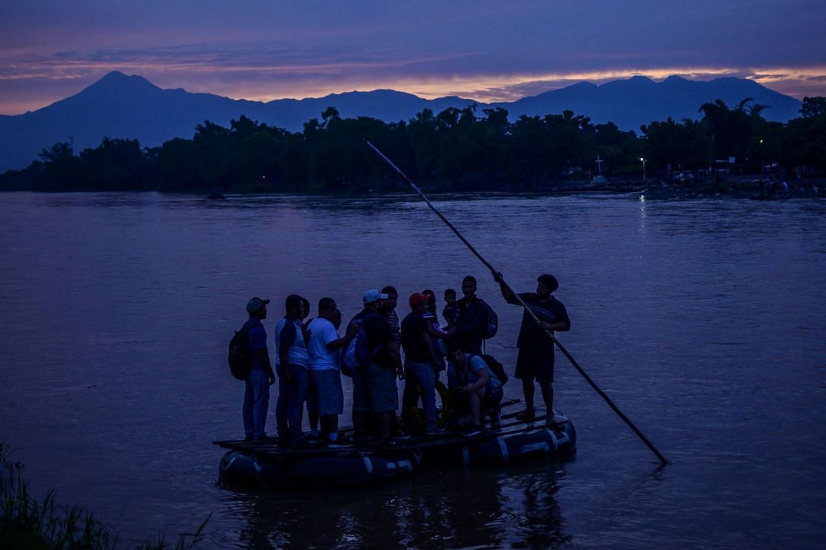 Central American migrants and locals arrive in Ciudad Hidalgo in Chiapas State, Mexico, after illegally crossing the Suchiate river from Tecun Uman in Guatemala in a makeshift raft, on June 10, 2019. PHOTO:  AFP