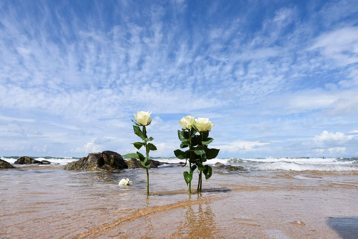 Flowers are seen on a beach of Les Sables-d'Olonne on June 10, 2019, after thousands of people took part in a tribute to three rescuers killed on June 7, when a SNSM vessel capsized in rough seas as a giant storm pummelled the country's Atlantic coas