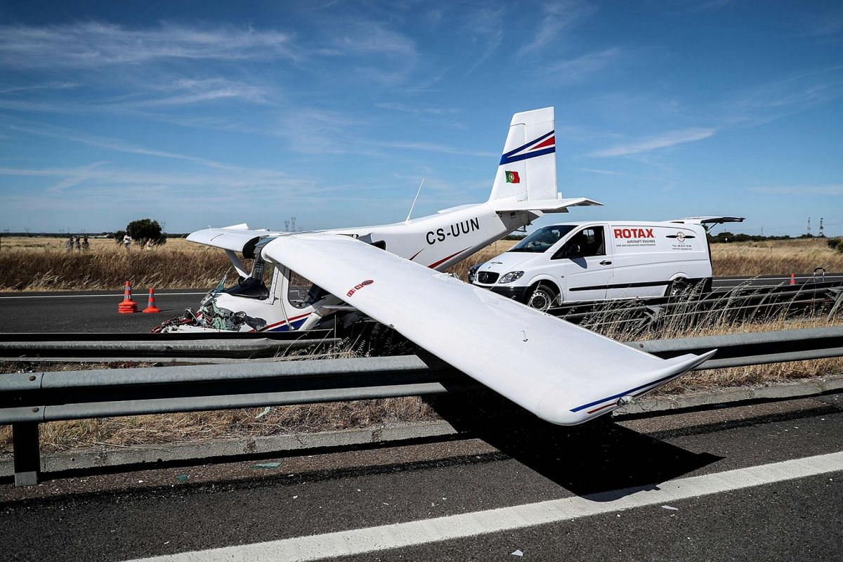 Wreckage of a small plane is pictured after crashing on a highway close to Pinhal Novo, on June 10, 2019. PHOTO:  AFP