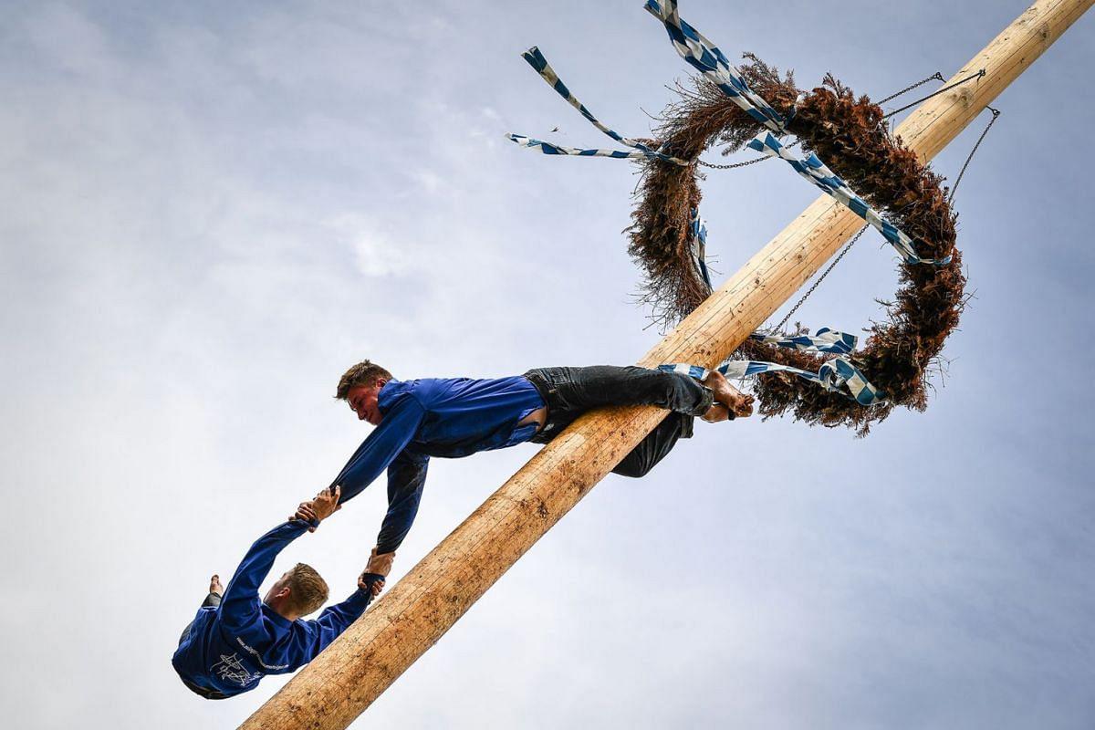 Competitors perform acrobatics on the maypole in Rottenstuben, Germany, June 10, 2019. PHOTO: EPA-EFE