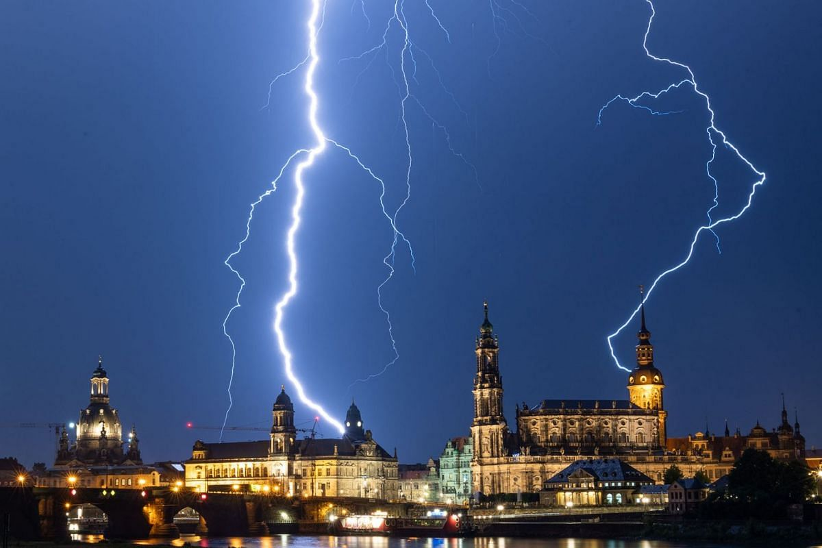 Lightning strikes are pictured above Saxon House of Estates, Town Hall, Dresden Cathedral and Hausmannsturm during a thunderstorm in Dresden, Germany on June 10, 2019. PHOTO: DPA