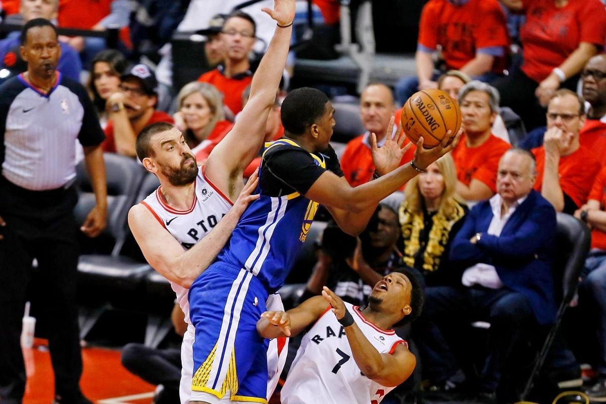 Golden State Warriors center Kevon Looney (5) collides with Toronto Raptors center Marc Gasol (33) and guard Kyle Lowry (right) during the third quarter in Game 5 of the NBA Finals at Scotiabank Arena in Toronto, Canada on June 10, 2019.