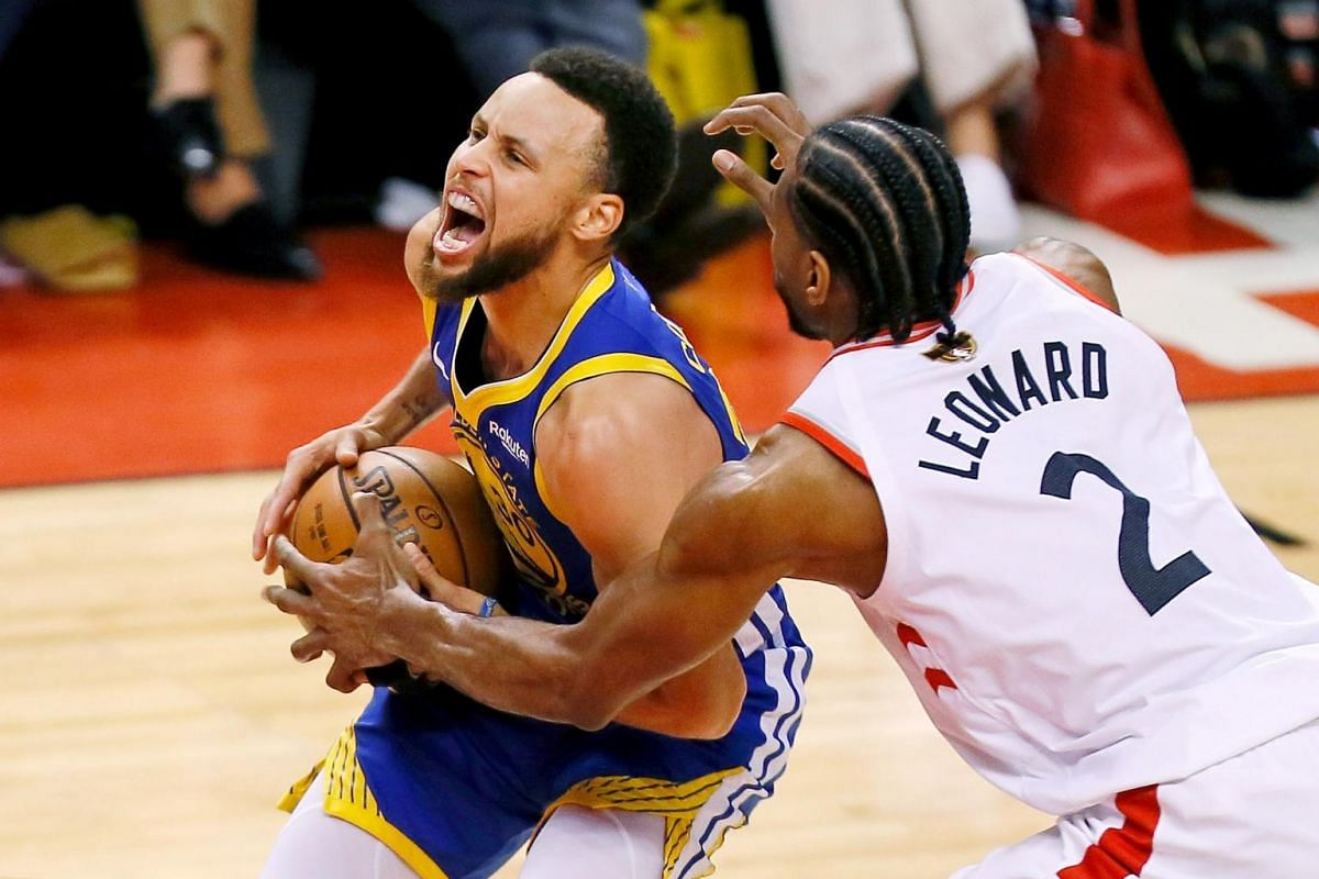 Golden State Warriors guard Stephen Curry (30) drives to the basket while defended by Toronto Raptors forward Kawhi Leonard (2) during the second quarter in Game 5 of the NBA Finals at Scotiabank Arena in Toronto, Canada on June 10, 2019.
