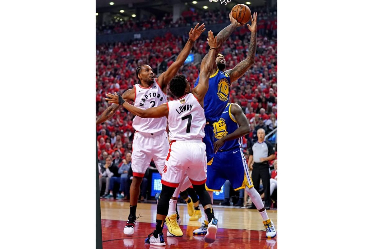 Golden State Warriors center DeMarcus Cousins (0) shoots the ball against Toronto Raptors forward Kawhi Leonard (2) and guard Kyle Lowry (7) during the second quarter in Game 5 of the NBA Finals at Scotiabank Arena in Toronto, Canada on June 10, 2019