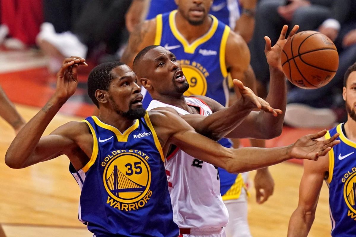 Golden State Warriors forward Kevin Durant (35) and Toronto Raptors center Serge Ibaka (9) go for a rebound during the first quarter in Game 5 of the NBA Finals at Scotiabank Arena in Toronto, Canada on June 10, 2019.