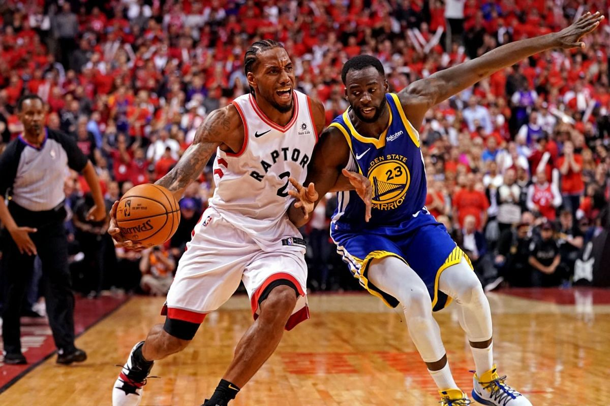 Toronto Raptors forward Kawhi Leonard (2) is fouled by Golden State Warriors forward Draymond Green (23) during the fourth quarter in Game 5 of the NBA Finals at Scotiabank Arena in Toronto, Canada on June 10, 2019.