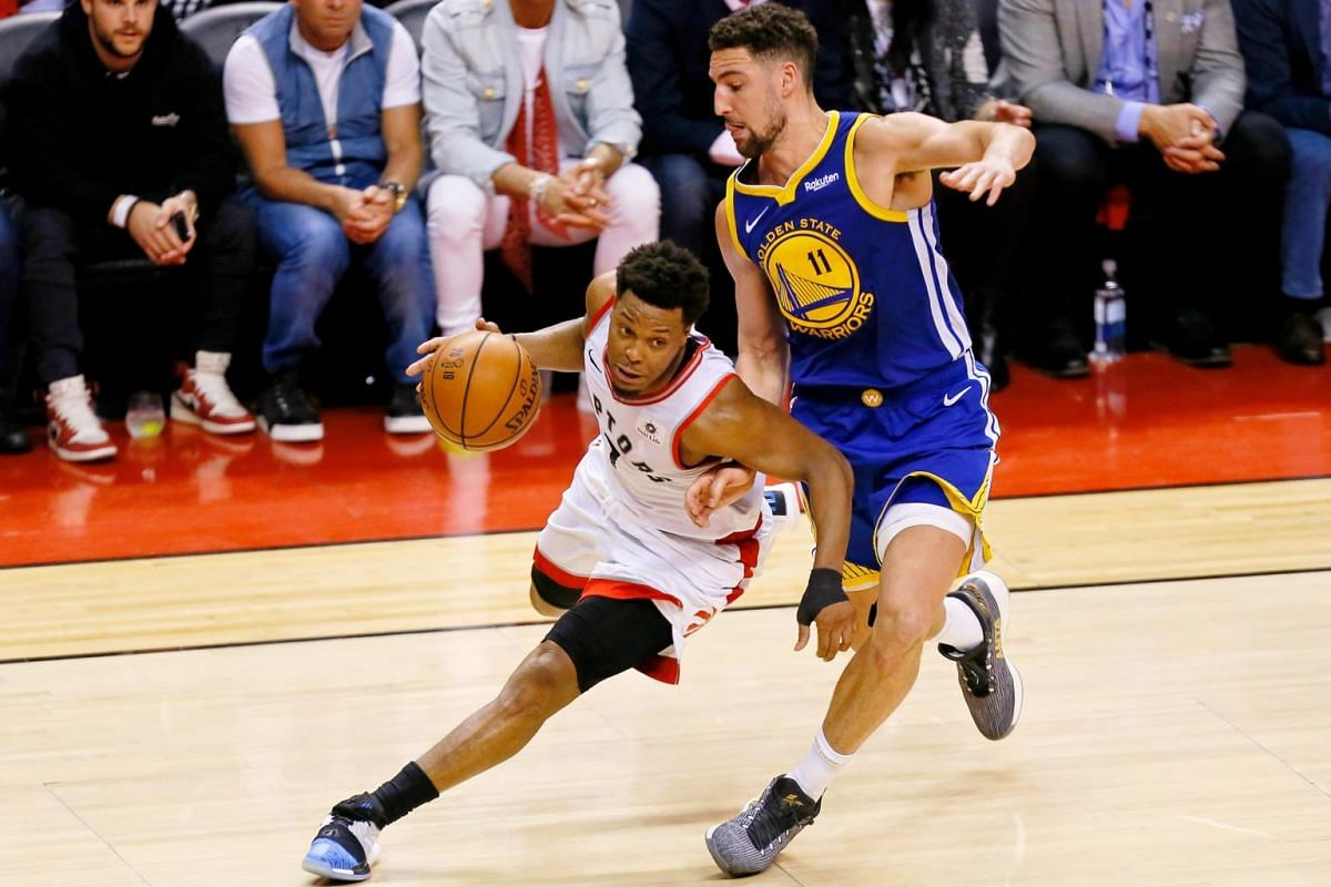 Toronto Raptors guard Kyle Lowry (7) dribbles while defended by Golden State Warriors guard Klay Thompson (11) during the fourth quarter in Game 5 of the NBA Finals at Scotiabank Arena in Toronto, Canada on June 10, 2019.