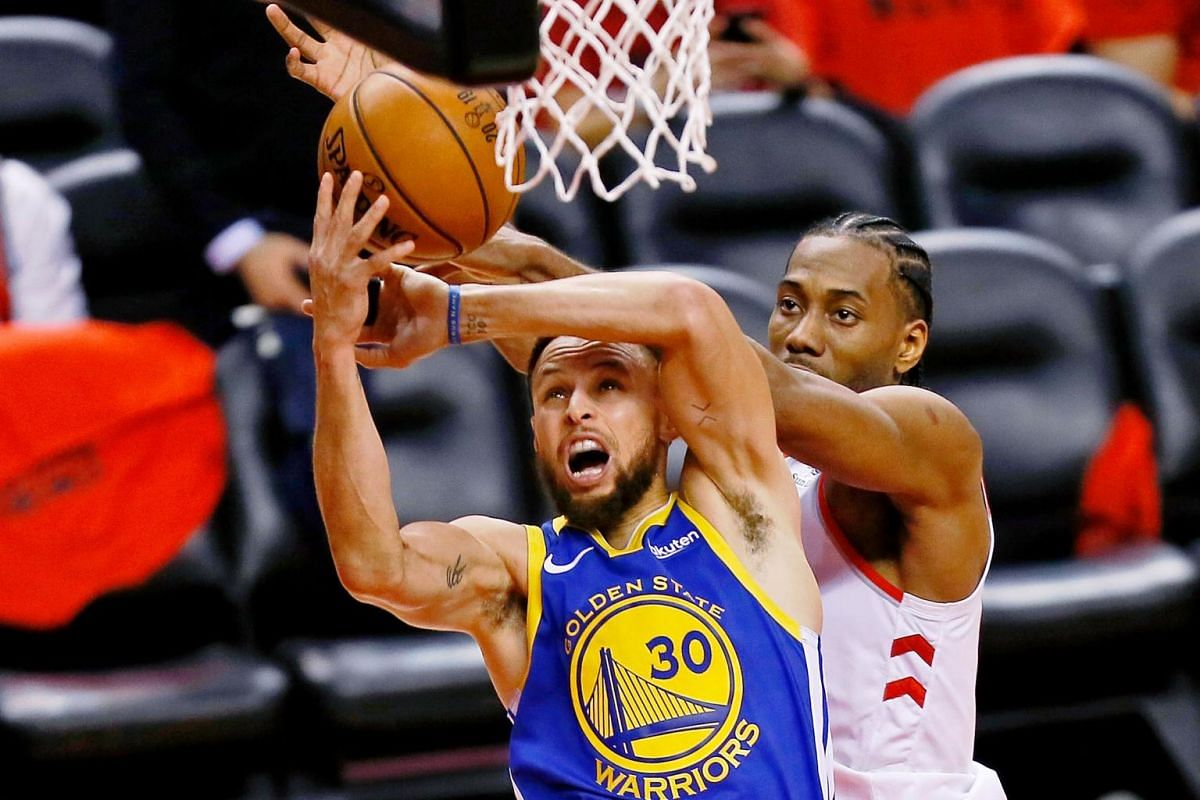 Golden State Warriors guard Stephen Curry (30) shoots while defended by Toronto Raptors forward Kawhi Leonard (2) during the third quarter in Game 5 of the NBA Finals at Scotiabank Arena in Toronto, Canada on June 10, 2019.