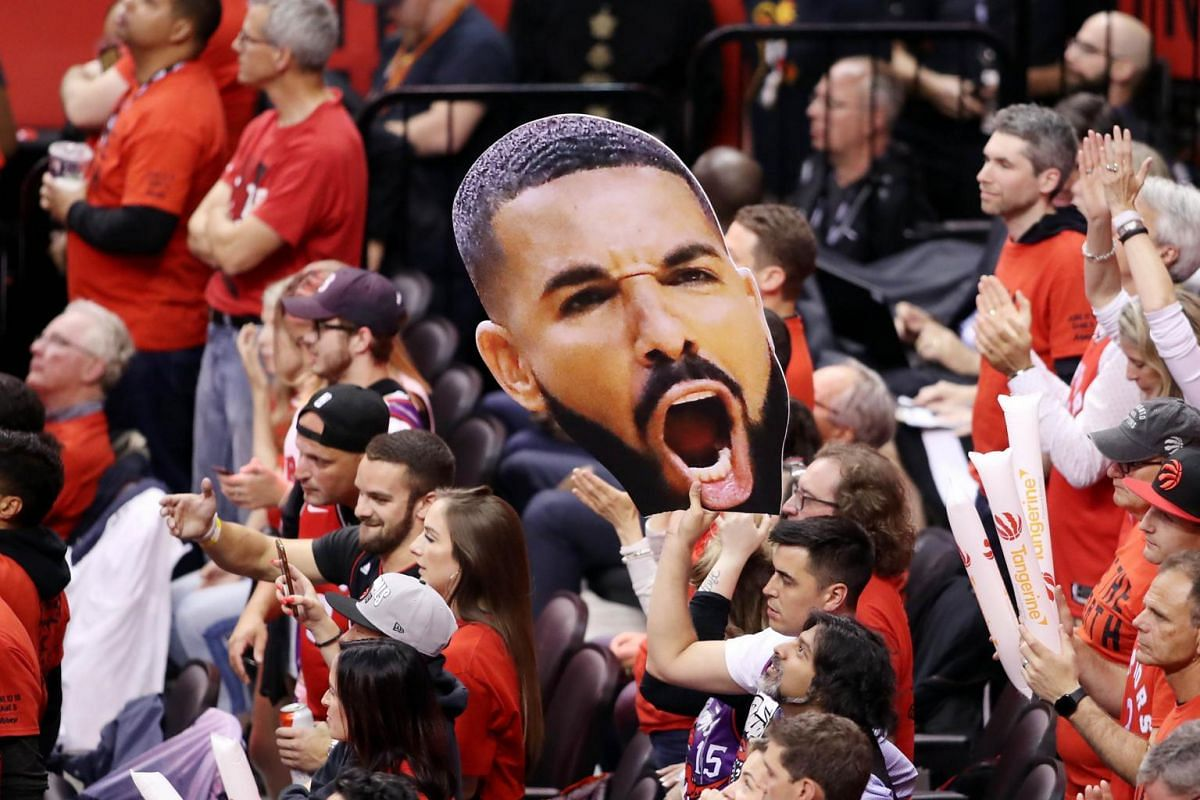 Fans hold up a large photo of Drake during Game 5 of the NBA Finals between the Golden State Warriors and the Toronto Raptors at Scotiabank Arena in Toronto, Canada on June 10, 2019.