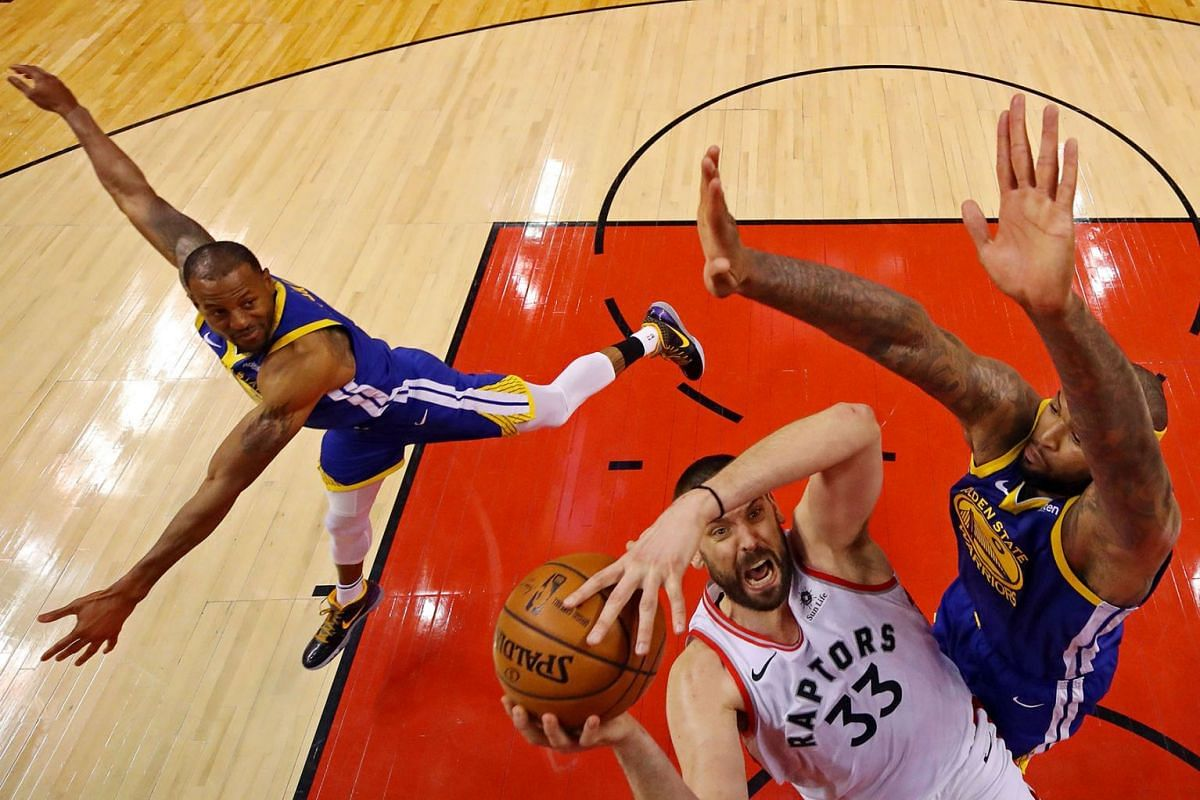 Toronto Raptors center Marc Gasol (33) shoots the ball against Golden State Warriors center DeMarcus Cousins (0) in game five of the 2019 NBA Finals at Scotiabank Arena on June 10, 2019, in Toronto, Ontario, Canada.