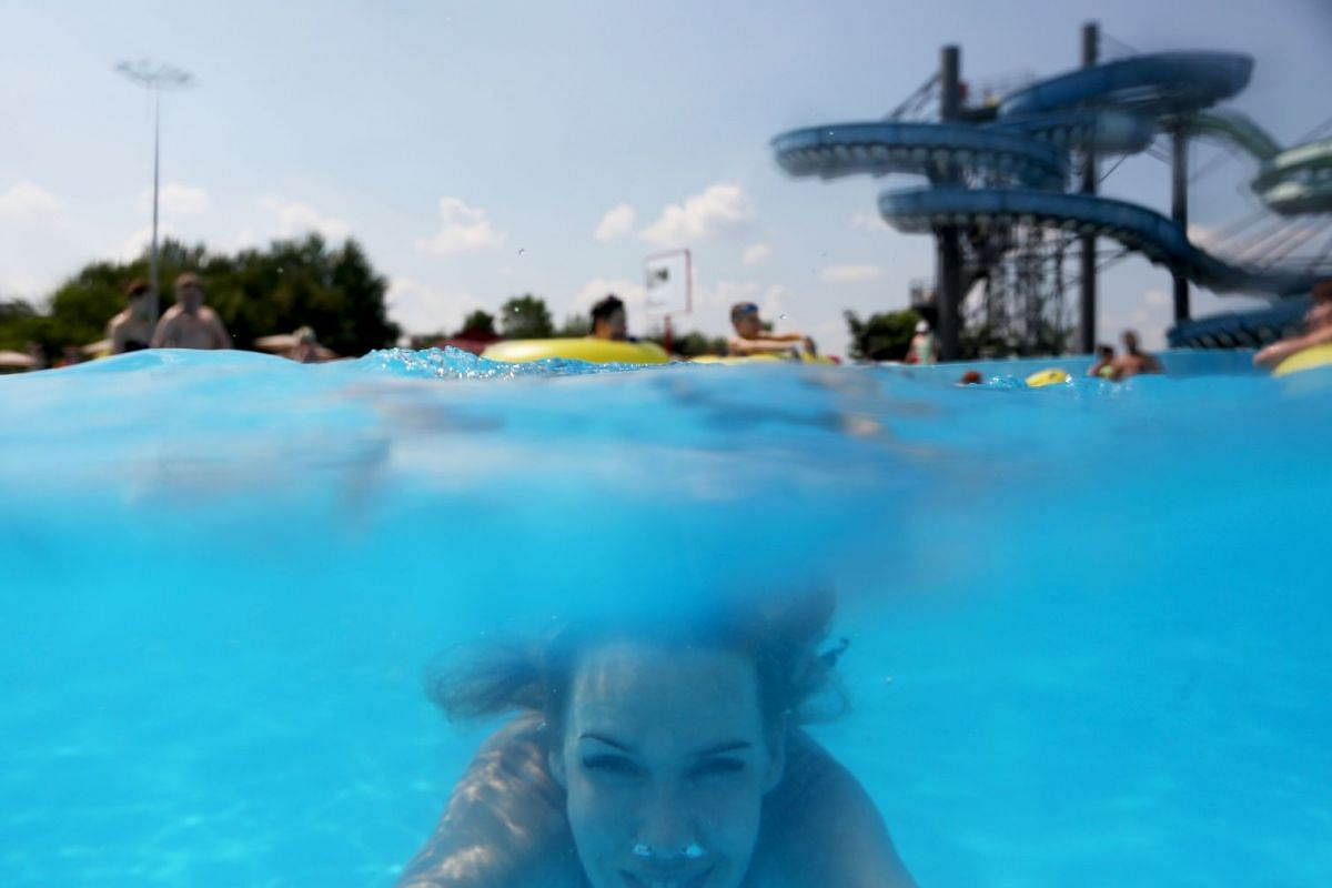 A visitor swims underwater at the open-air aquapark 'Dreamland' in Minsk, Belarus, June 12, 2019. Aquapark 'Dreamland' is considered one of the biggest open-air aquaparks in Europe and covers nine hectares. Local media report that Minsk is experienci