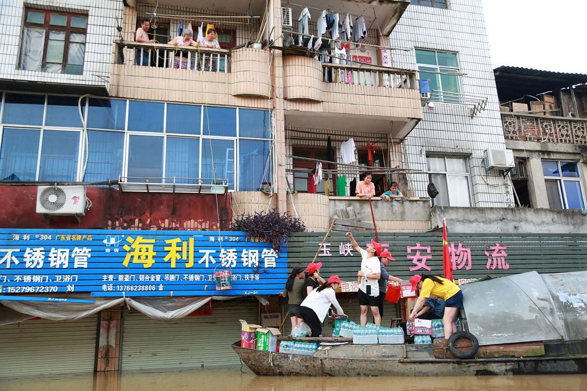 A photo issued on June 12, 2019 shows local government personnel rowing a boat on a flooded street transporting food supplies to stranded residents following heavy rainfall in Jian, Jiangxi province, China June 10, 2019. PHOTO: REUTERS