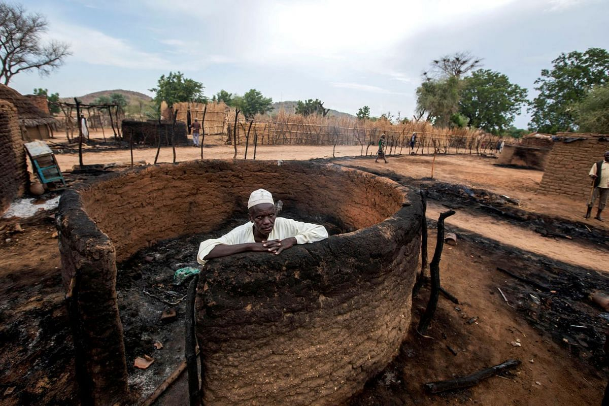 A man is seen inside a burnt house during clashes between nomads and residents in Deleij village, located in Wadi Salih locality, Central Darfur, Sudan June 11, 2019. PHOTO: REUTERS